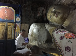 The incumbent Buddha carved into the granite cave