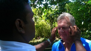 Paul experiencing some Ayurveda treatment at the spice and herb garden.