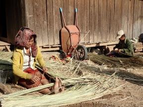Weaving a roof, in a Khmu village.